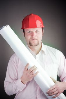Free Young Attractive Engineer With Blueprints Stock Images - 17686434