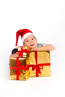 Free Little Boy In Santa Hat With A Bunch Of Gifts Royalty Free Stock Image - 17686776