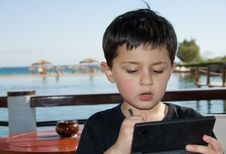 Boy Playing Game Stock Images