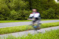Free Blurred Man Riding Bicycles Along A Country Road Royalty Free Stock Photos - 17689618