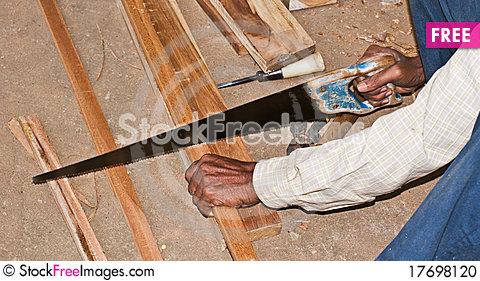 Free Cutting Wood By Hand Saw Stock Photo - 17698120