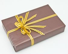 Free Black Gift Box With White Bar Attached Gold Ribbon Royalty Free Stock Photos - 17692328