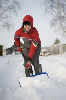 Free The Girl In A Red Jacket And A Hood Cleans Snow A Stock Photos - 17693323