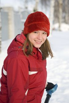 The Girl In A Winter Red Cap Smiles Stock Photography
