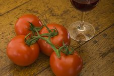 Free Tomatoes And A Glass Of Red Wine Royalty Free Stock Photography - 17695217