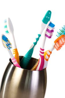 Free Toothbrushes In Metal Cup Stock Photo - 17695560