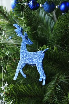 Blue Raindeer Ornament Hanging From Tree Stock Photos