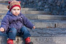Beautiful Baby Sitting On Stairs Stock Images