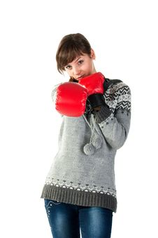 Free Beautiful Girl In Boxing Gloves Punching Royalty Free Stock Photos - 17699688