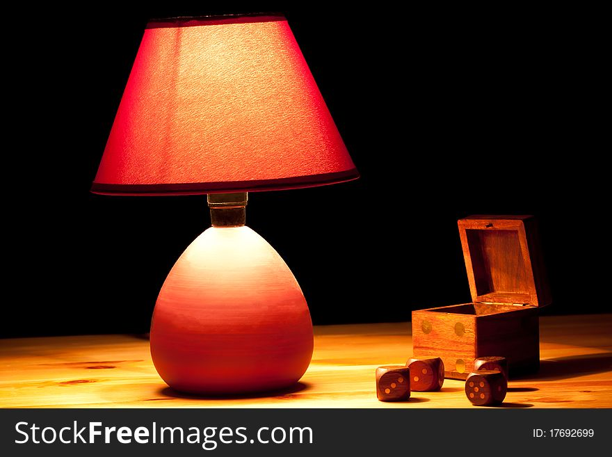 Lamp illuminating dice