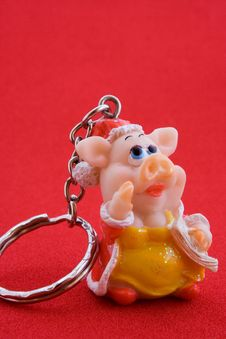 Free Trinket In The Form Of Pig On Red Stock Images - 1775104