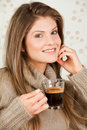 Free Young Girl Holding A Cup Of Coffee And Smiling Royalty Free Stock Photography - 17708157
