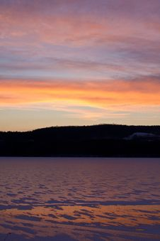 Sunset Over Frozen Lake Stock Photo
