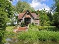 Free Quaint Riverside Cottage Stock Images - 17716914