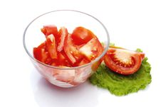 Free Red Tomato  Sliced Into Pieces  In A Glass Bowl Stock Photography - 17711832