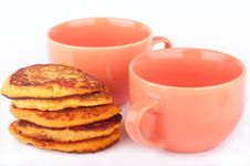 Free Pumpkin Pancakes And Two Orange Cups For Breakfast Stock Images - 17715384