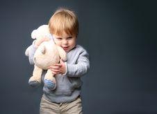 Free Baby Hugging Teddybear Stock Photography - 17715612