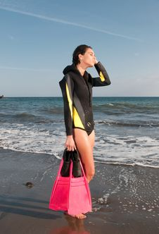 Woman In The Seaside After Dive Stock Photo