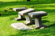 Free Stone Chairs Standing On The Garden Stock Images - 17717084