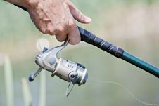 Fisherman Hand Holding A Fishing Rod Royalty Free Stock Photography