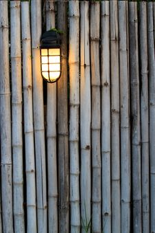Free Yellow Lamp On The Bamboo Fence Stock Image - 17719481