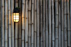 Free Yellow Lamp On The Bamboo Fence Royalty Free Stock Photography - 17719487