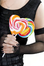 Free The Young Girl Is Holding A Lollypops Royalty Free Stock Images - 17726949