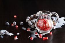Red Granules Of Pomegranate In A Glass Jug Stock Image