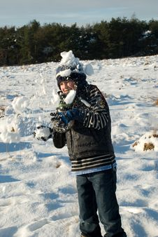 Little Boy Having Fun In Snow With Snowballs Stock Photos