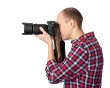 Young Photographer With Camera Stock Photo