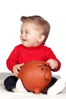 Free Beautiful Blond Baby With A Piggy-bank Royalty Free Stock Photos - 17730338