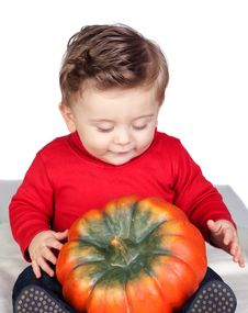 Beautiful Blond Baby With A Big Pumpkin Stock Image