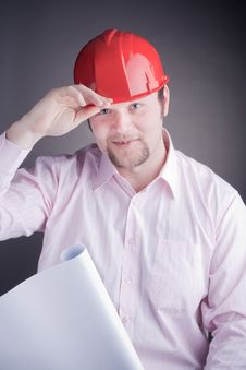 Young Engineer With Blueprints Raises His Hat Stock Photography