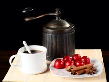 A Cup Of Coffee With Grinder And Sweets.