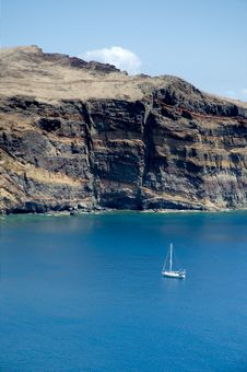 Free Sailboat Anchored Near Cliff Royalty Free Stock Photography - 17734027