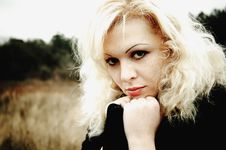 Free Beautiful Young Blonde In Black Coat Stock Images - 17735594