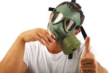 Gas Mask Man Smoking Stock Image