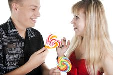 Free Young Man Treats The Girl With A Lollipop Royalty Free Stock Photo - 17737485