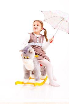 Free Girl Sitting On Rocking Horse Stock Image - 17738041