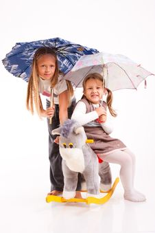 Two Girls With Umbrellas Stock Image