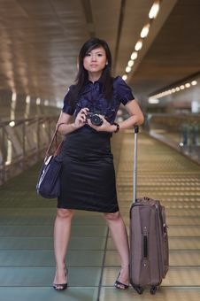 Asian Tourist Posing With Her Camera Royalty Free Stock Images