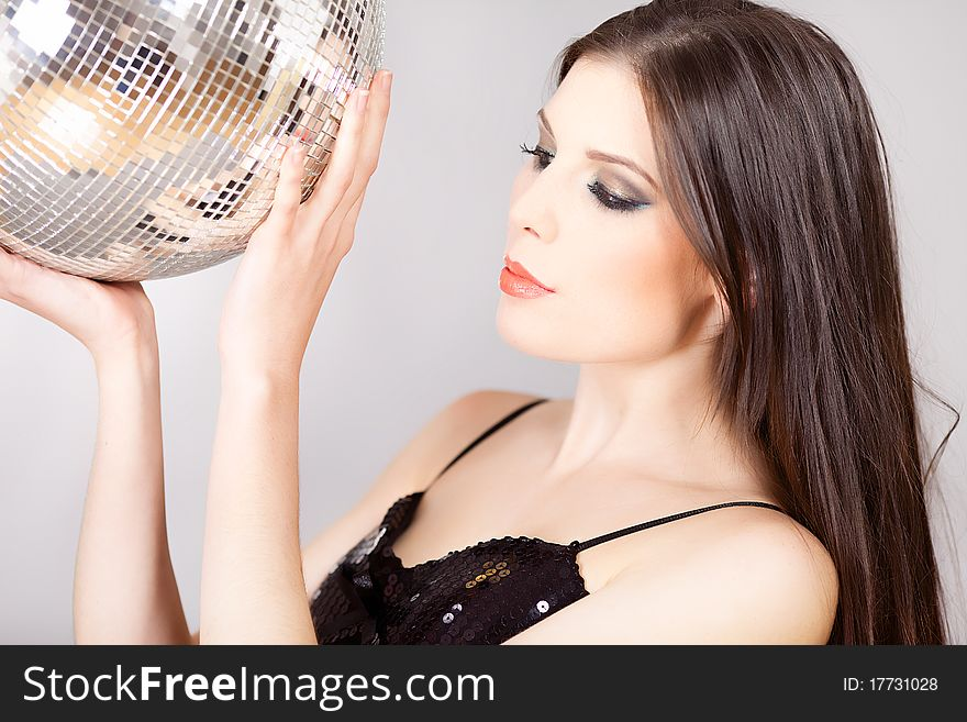 Portrait of a woman with Disco ball