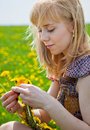 Free A Woman Is Sitting On A Field Stock Photography - 17745242