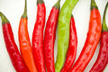 Free Red And One Green Spicy Chili Peppers Royalty Free Stock Photography - 17749097