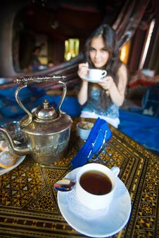 Free Beautiful Asian Girl Drinking Tea Royalty Free Stock Photography - 17742327