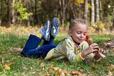 Free A Girl Is Laying On A Grass In The Forest Stock Photos - 17745213