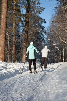 Free Man And Woman Walking On Ski In Winter Forest Stock Photo - 17747150