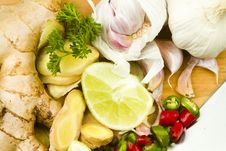 Fresh Garlic, Ginger, Chillies And Limes Stock Photography