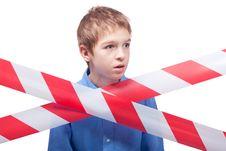 Free Boy Behind Cordon Tape Royalty Free Stock Photography - 17752177