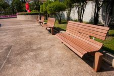 Wooden Bench In The Park. Stock Photo